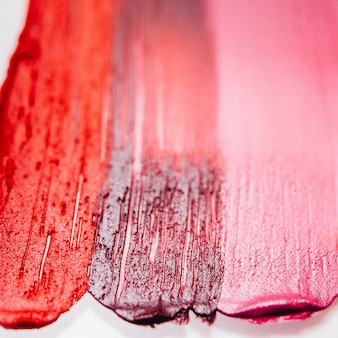 Smeared lipstick. beauty art business. textured strokes samples. decorative background.
