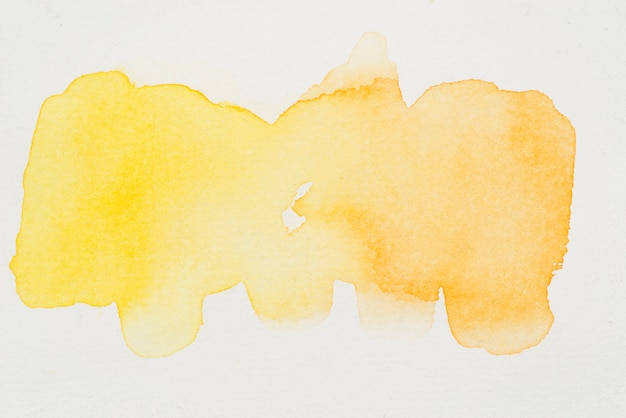 Smears of bright yellow watercolor