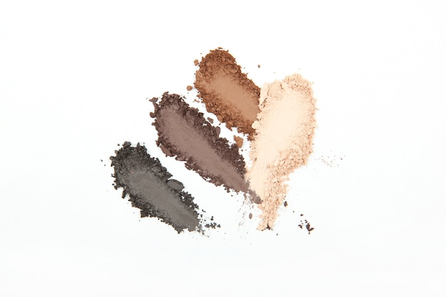 Smears of different decorative cosmetics on a white background isolated