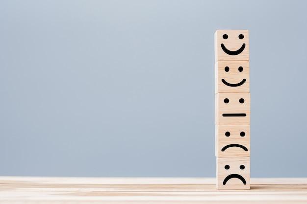 Smile face symbol on wooden blocks