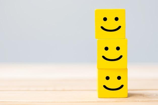 Smile face symbol on yellow wooden blocks