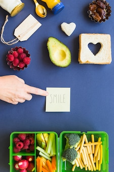 Smile sign concept with vegan lunch space