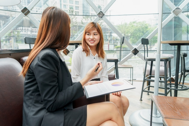 Smiled business woman talking and thinking about their work - business meeting concept.