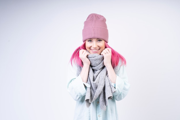 Smiled girl with scarf and rose hat