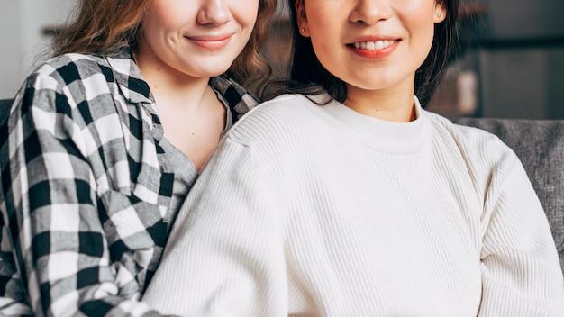Smiles of multiracial girlfriends