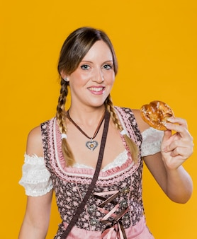 Smiley bavarian woman with pretzel