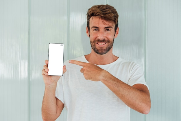 Smiley bearded man showing cellphone