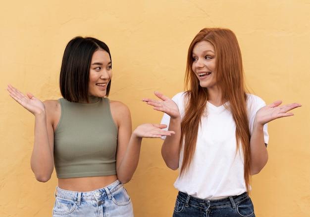 Smiley beautiful women posing together