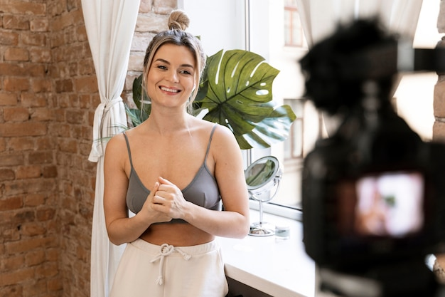 Smiley beauty vlogger doing a video