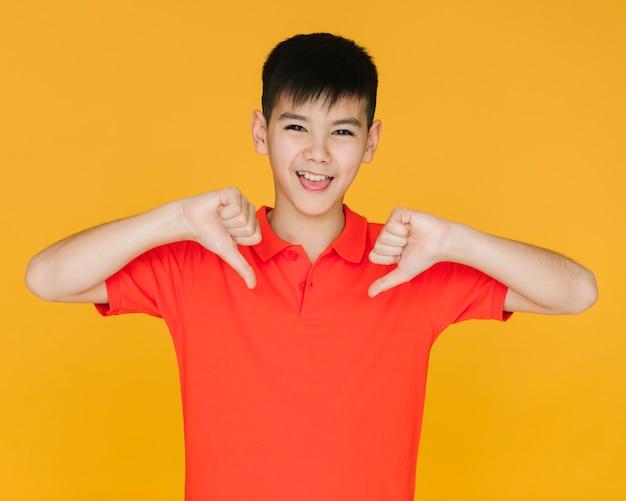 Smiley boy giving the dislike sign