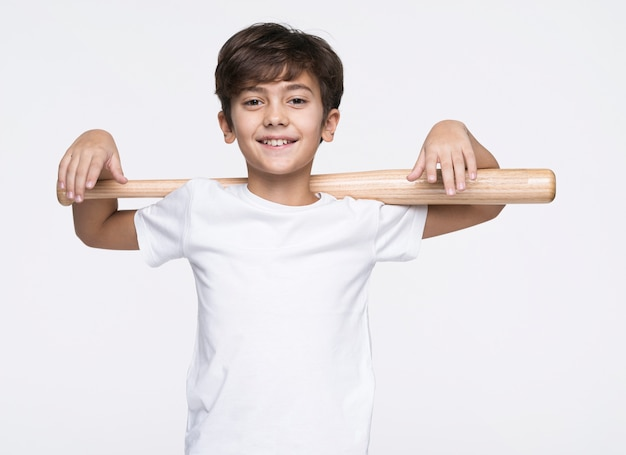 Smiley boy holding baseball bat