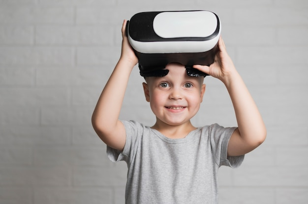 Smiley boy playing with vr headset