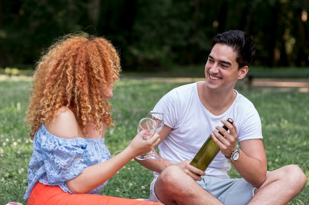 Smiley boyfriend looking at his girlfriend