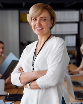 Smiley businesswoman in conference room