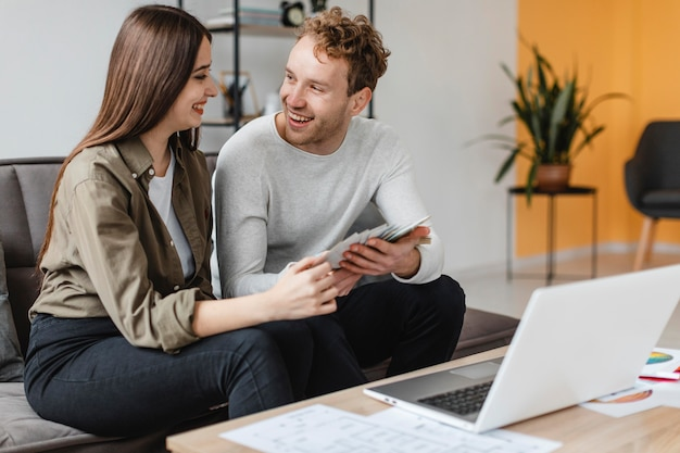 Smiley couple making plans to remodel the home together