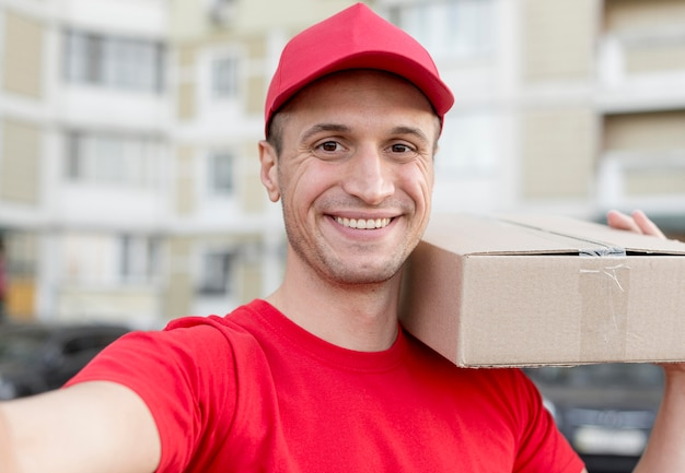 Smiley delivery guy taking selfie