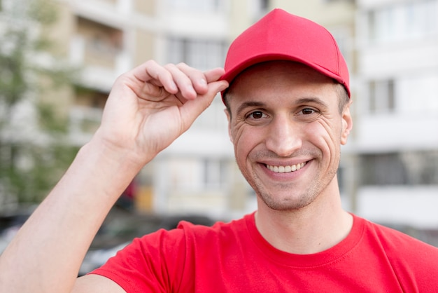 Smiley delivery guy wearing hat