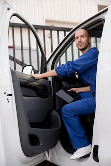 Smiley delivery man in van