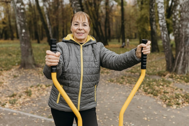 Smiley elder woman working out outdoors