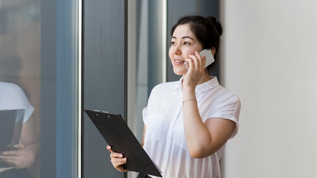 Smiley entrepreneur talking on phone