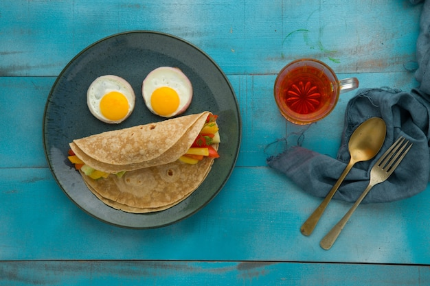 Smiley face food item chapati healthy food made of wheat flour and it is stuffed with vegetables