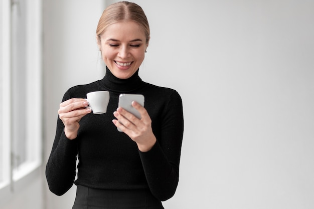 Smiley female drinking coffee