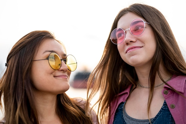 Smiley female friends with sunglasses