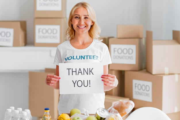 Smiley female volunteer thanking you for donating food