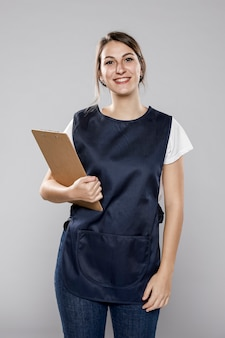 Smiley female worker with apron