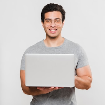 Smiley fit student holding laptop