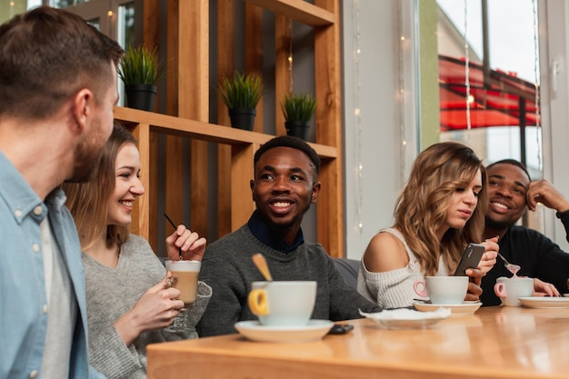 Smiley friends enjoying cup of coffee