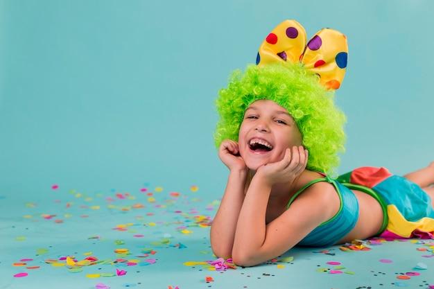 Smiley girl in clown costume