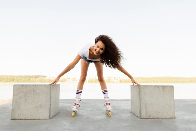 Smiley girl having fun with her rollerblades