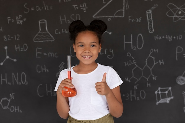 Smiley girl learning more about chemistry in class