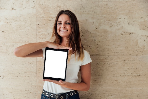 Smiley girl showing tablet with mock-up