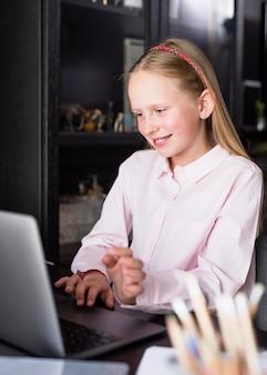 Smiley girl using her keyboard