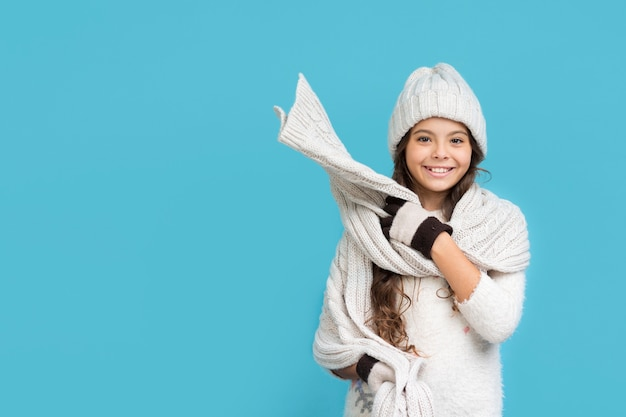 Smiley girl in winter clothing copy-space