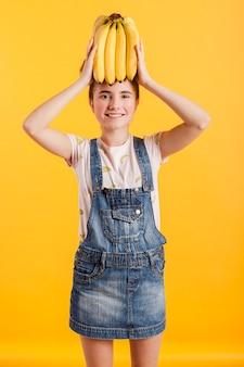 Smiley girl with bananas