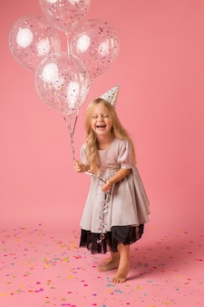 Smiley girl with costume and balloons