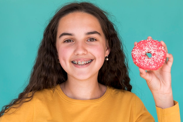 Smiley girl with glazed doughnut