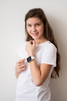 Smiley girl with smartwatch