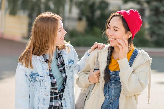 Smiley girlfriends outdoor