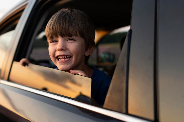 Smiley kid at car window