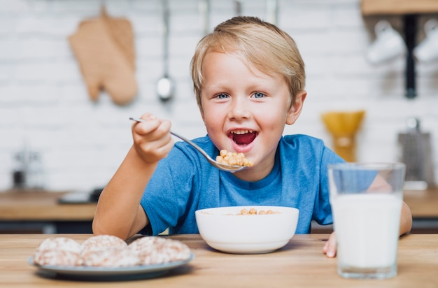 Smiley kid eating cereal