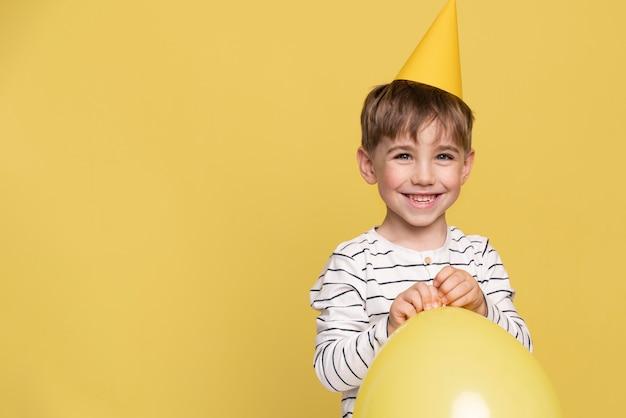 Smiley little boy isolated on yellow