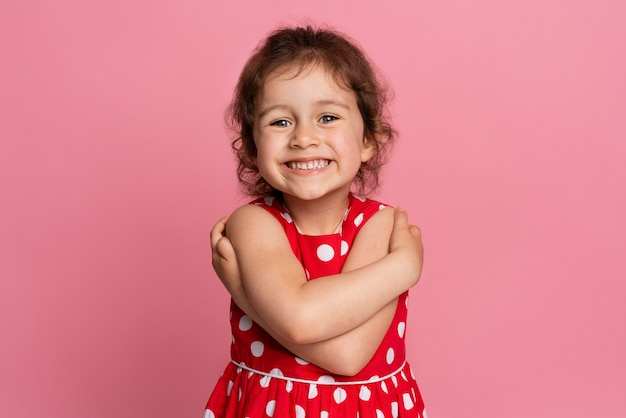 Smiley little girl in a red dress