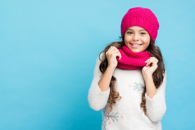 Smiley little girl with hat and scarf
