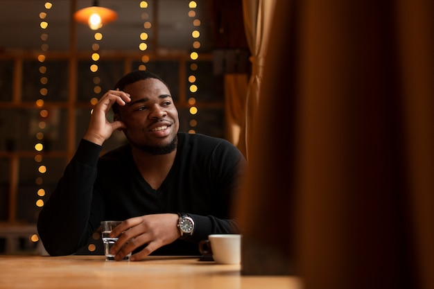 Smiley male enjoying cup of coffee