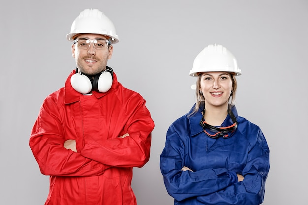 Smiley male and female construction workers