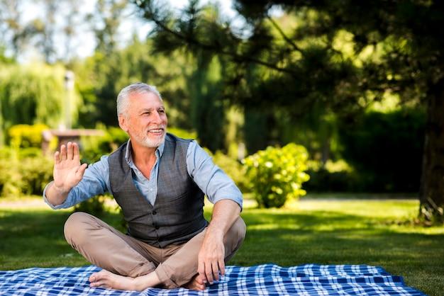 Smiley man enjoying his time at nature